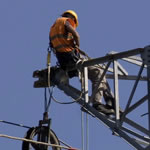 Man working in heights on electrical tower